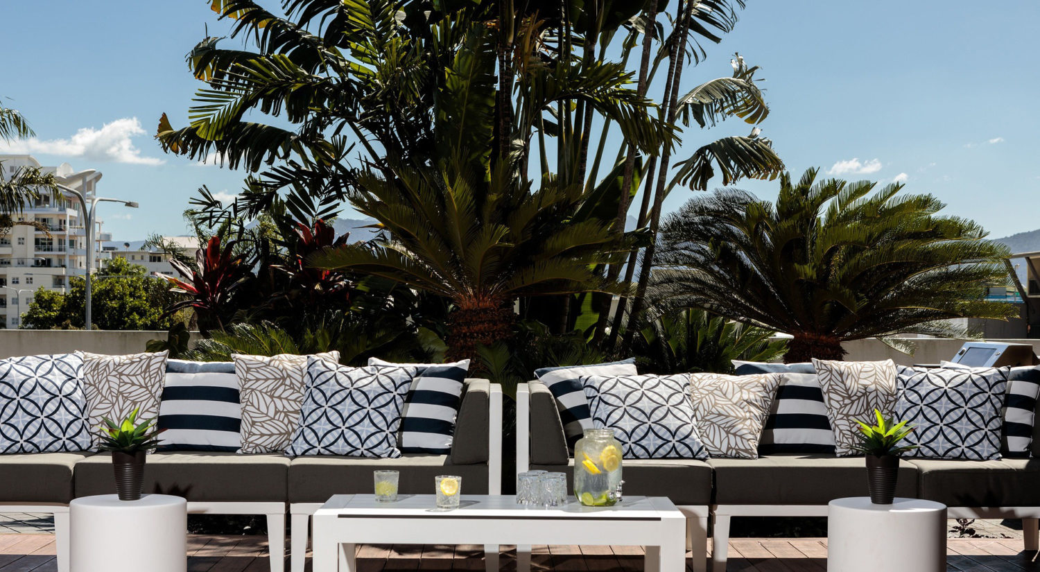 1-cairns-resort-accommodation-pool-seating | The Benson Hotel